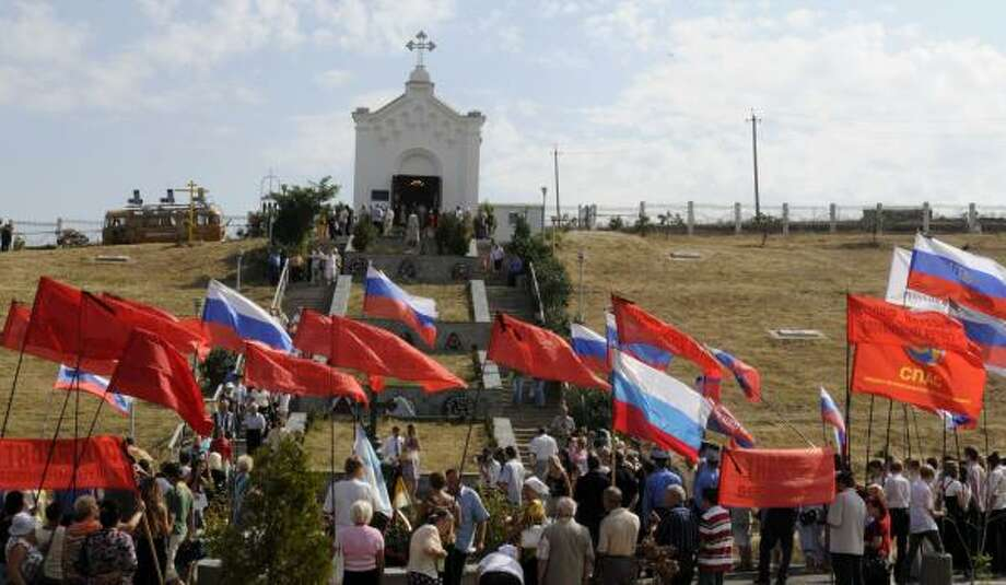 Pro-Russian activists in the Ukraine last month celebrate the anniversary of the 19th-century war over the Crimea, where about 35,000 Russian troops were killed. Photo: SERGEI CHUZAVKOV, ASSOCIATED PRESS