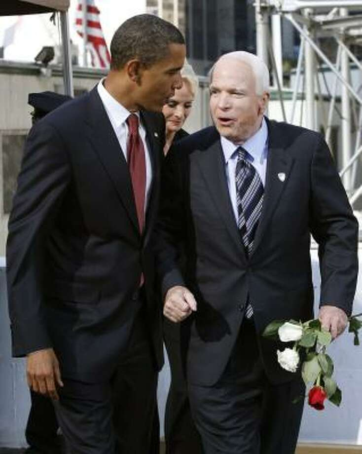 Democratic presidential candidate Sen. Barack Obama, left, and Republican presidential candidate Sen. John McCain pay their respects at the site of the World Trade Center during a Sept. 11 commemoration ceremony in New York. 60 Minutes' separate pieces on each will mix profiles with a snapshot of a moment in the campaign. Photo: SHANNON STAPLETON, ASSOCIATED PRESS