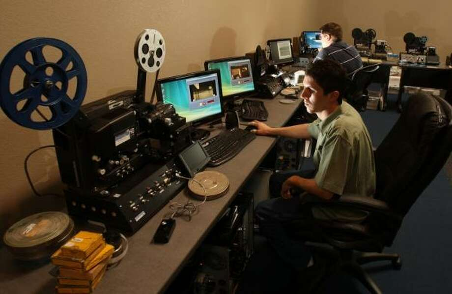 IMemories employees convert film at the company's Scottsdale, Ariz., facility. The company takes analog recordings and changes them for the digital age. Photo: ROSS D. FRANKLIN, ASSOCIATED PRESS
