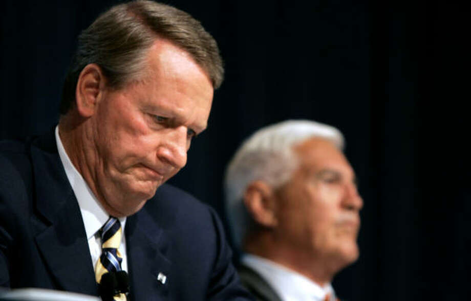 General Motors chairman and CEO Rick Wagoner listens during a news conference in Detroit with company Product Development Vice Chairman Bob Lutz, right. Photo: Carlos Osorio, Associated Press