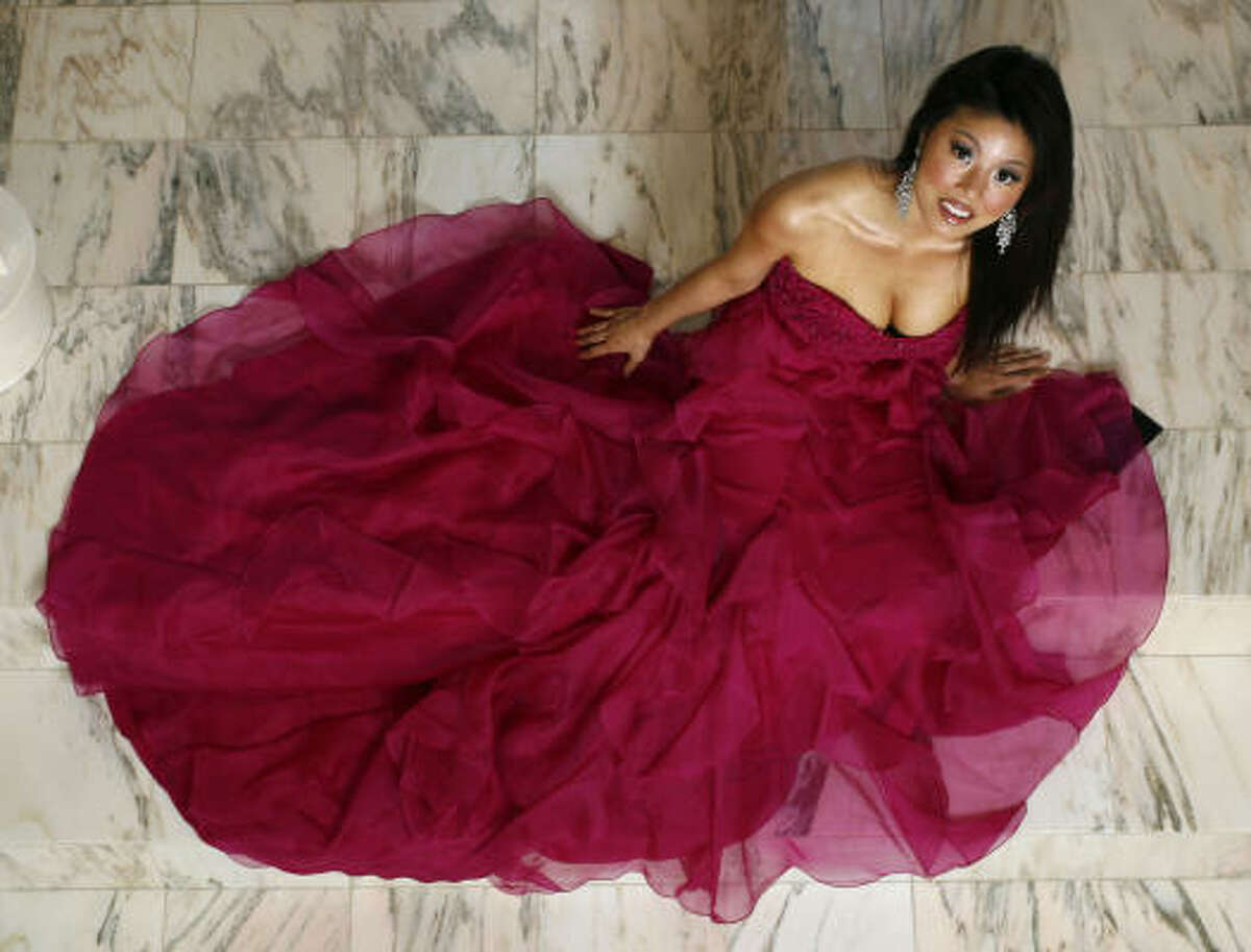 Miss Asia USA Diane Yoo models a fuchsia Marchesa gown at her home in Katy. The pageant winner says she will use her reign to inspire young girls of Asian descent.