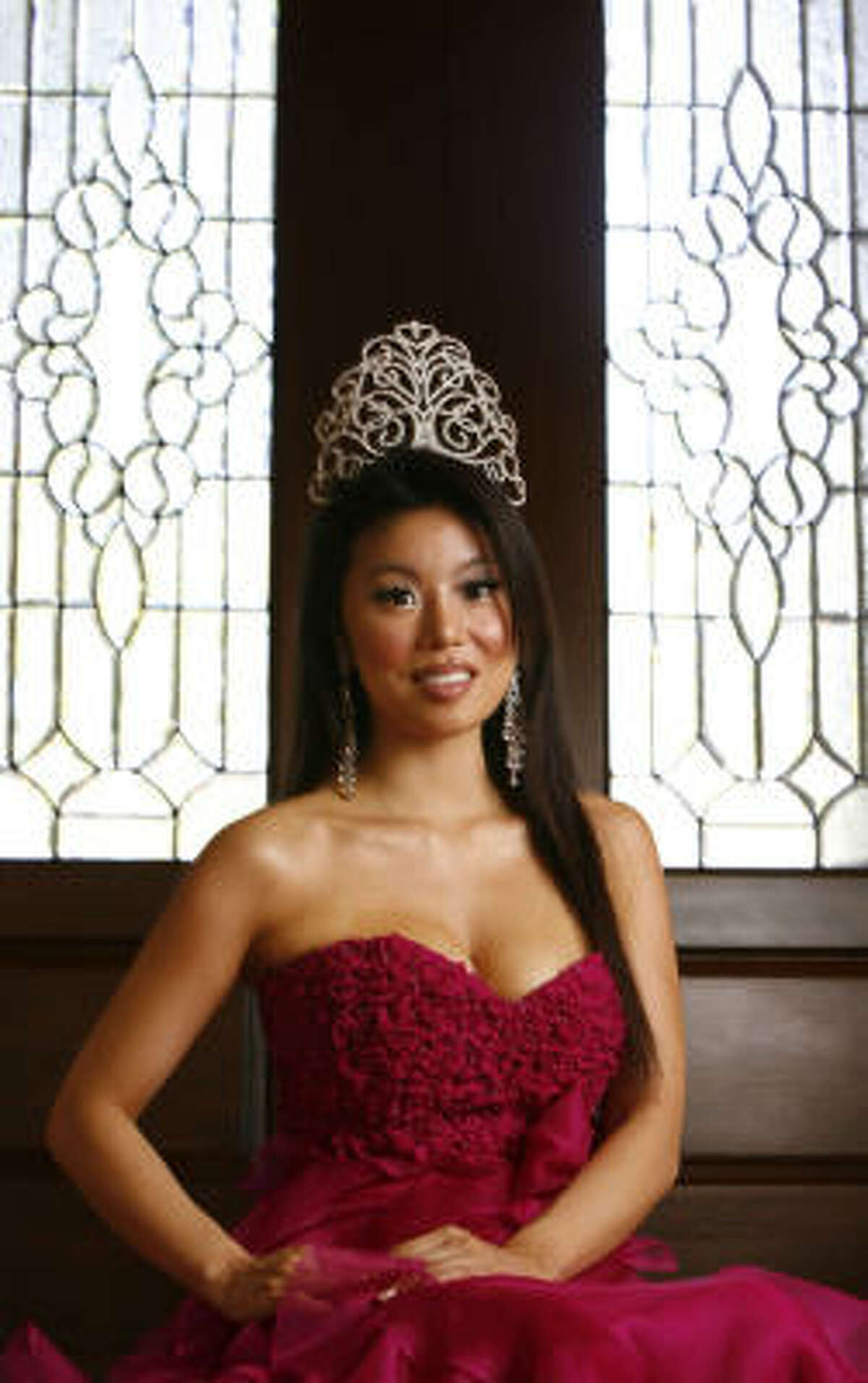 Yoo, who was crowned a few months ago, poses at her home in Katy.