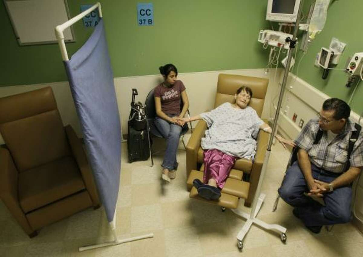 Patient Mary Ann McClintock of Katy, center, with granddaughter Catherine Hatfield, 15, and husband Chester McClintock wait in the continuing care section of the emergency room at Memorial Hermann Memorial City.