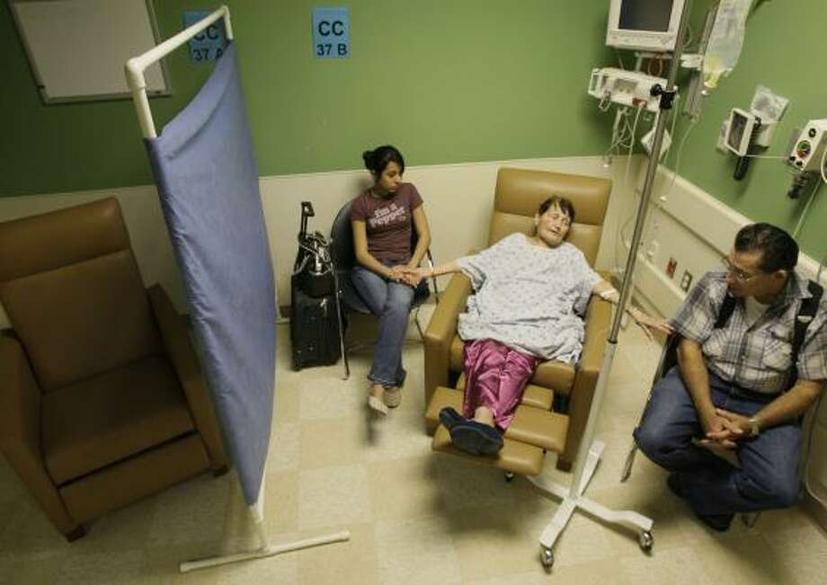 Patient Mary Ann McClintock of Katy, center, with granddaughter Catherine Hatfield, 15, and husband Chester McClintock wait in the continuing care section of the emergency room at Memorial Hermann Memorial City. Photo: MELISSA PHILLIP, CHRONICLE