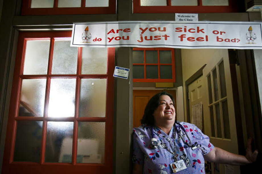 WORRIES: School nurse Anne DeLay says some parents send sick children to school because they can't skip a day of work. Photo: Michael Paulsen, Chronicle