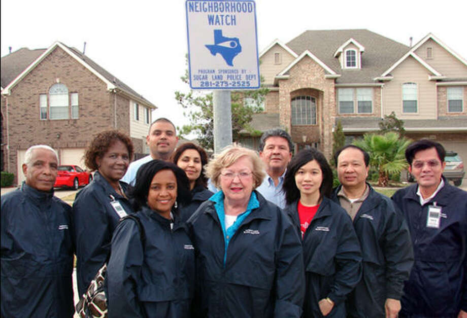 Ashford Lakes block captains recently gathered to erect their new Neighborhood Watch signs.  From left are block captains Alebachew Belay, Yvonee Jove and Hanna Belay; Sugar Land Traffic Tech Jason Abila; block captains Jasmine Yousef and Alice Schrag; Sugar Land Signs and Markings Supervisor Ray Vela; and block captains Nancy Vu, Dr. Jimmy Vu and David Lee. Photo: Courtesy, City Of Sugar Land