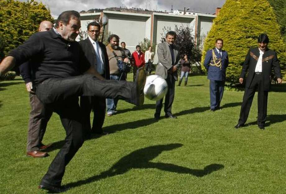 In this photo released by Bolivia's Presidency,  U.S. film director Oliver Stone, left, kicks a ball during a visit to the Bolivia's President Evo Morales, right,  in La Paz Tuesday. Photo: Jose Luis Quintana, AP