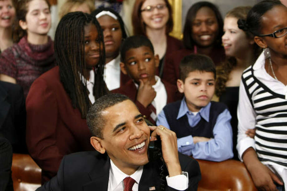 President Barack Obama, accompanied by members of Congress and schoolchildren, talks to astronauts on the international space station on Tuesday. Photo: Gerald Herbert, Associated Press