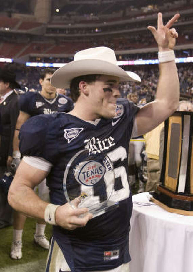Rice quarterback Chase Clement waves to the crowd after being presented with the Most Valuable Player trophy after Rice won the Texas Bowl. Photo: Brett Coomer, Houston Chronicle