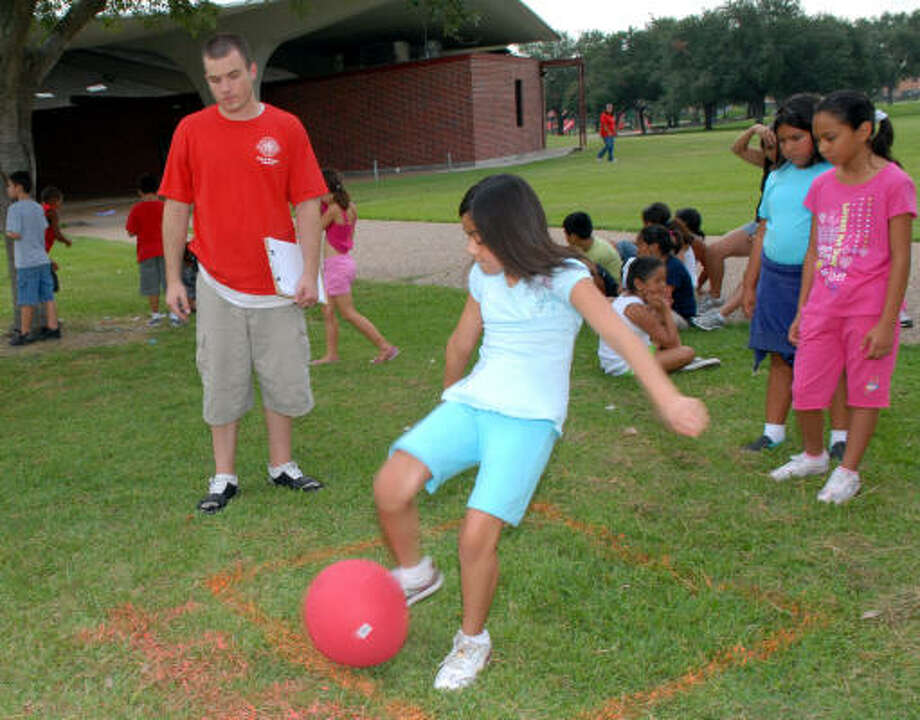 READY TO LAUNCH: Michelle Esparaza, 9, kicks the ball as Casey Brock, left, and Jennifer Godinez and Arcely Vicra, both 9, look on during last year's Pasadena Street Olympics. The Olympics returns July 15 at the Strawberry Park Pavillion. Photo: Kim Christensen, For The Chronicle