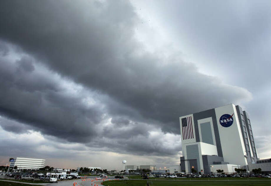 A line of thunderstorms moves over Kennedy Space Center in Cape Canaveral, Fla., on Sunday, when NASA delayed Endeavour's liftoff. Photo: Chris O'Meara, Associated Press