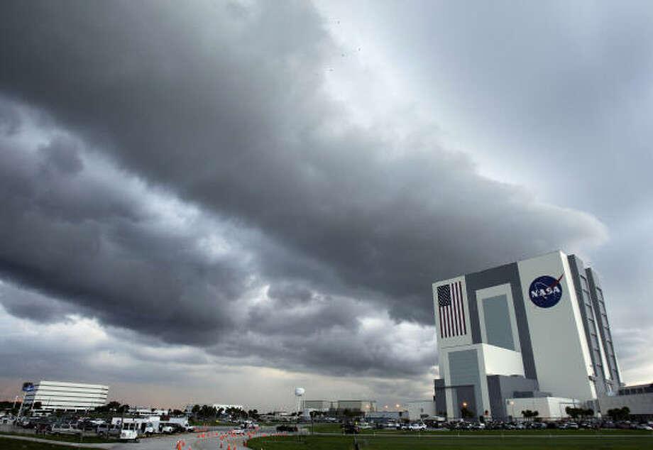 Storms force NASA to scrub shuttle launch — again ...