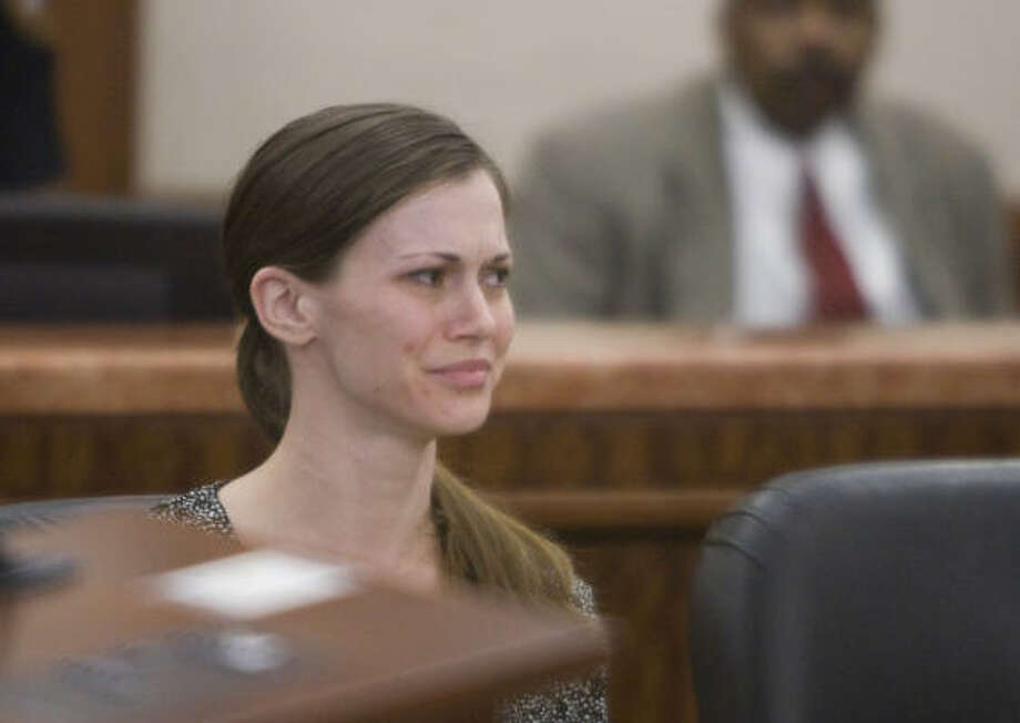 Katherine Nadal listens to opening statements Monday as she stands trial for allegedly mutilating her 5-week-old son in her apartment in 2007. Photo: Nick De La Torre, Chronicle