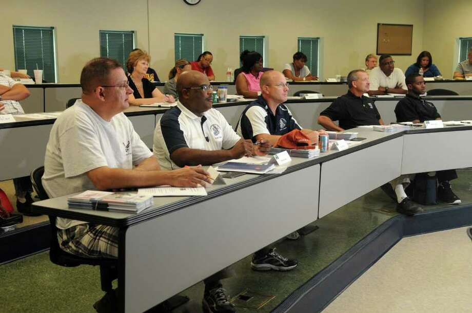 Scott Newberry, from left, Kingwood Park AFJROTC, Damond Banks, Kingwood High School NJROTC, Greg Boucher, NJROTC, Robert Rohm, Humble High School AJROTC, and David Watkins, Humble HS AJROTC, listen to Harris County Emergency Management Coordinator Mark Sloan during a CERT training class for Humble ISD staff members at the Harris County Fire and Sheriff Training Academy. Freelance photo by Jerry Baker Photo: Jerry Baker, Freelance
