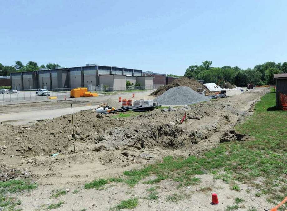 Excavation work for the Greenwich High School auditorium project, pictured Tuesday afternoon, has unearthed traces of soil contaminants including arsenic and lead.  Excavation in the area where workers discovered the contaminants has been halted. Photo: Bob Luckey / Greenwich Time