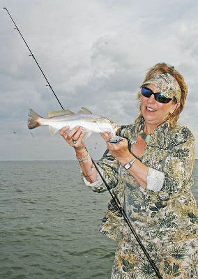 Sand trout - a smaller, spotless cousin of speckled trout - are one of the most common fish found under hovering gulls in Texas bays during autumn. Photo: Chronicle Photo By Shannon Tompk