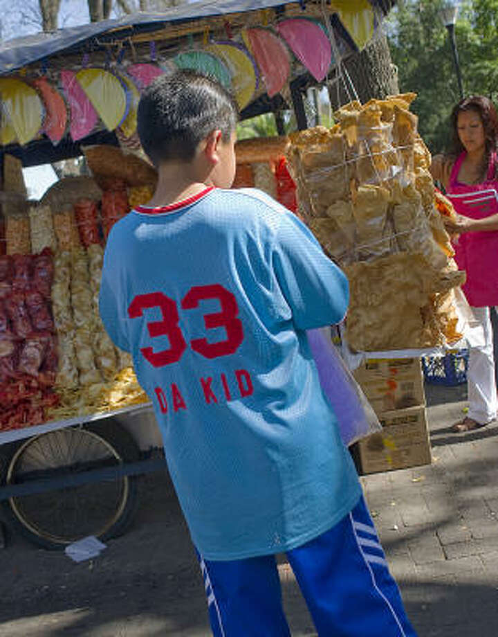 Across Mexico, sidewalk vendors with unhealthy offerings wait for students after classes let out. Photo: Keith Dannemiller, Chronicle