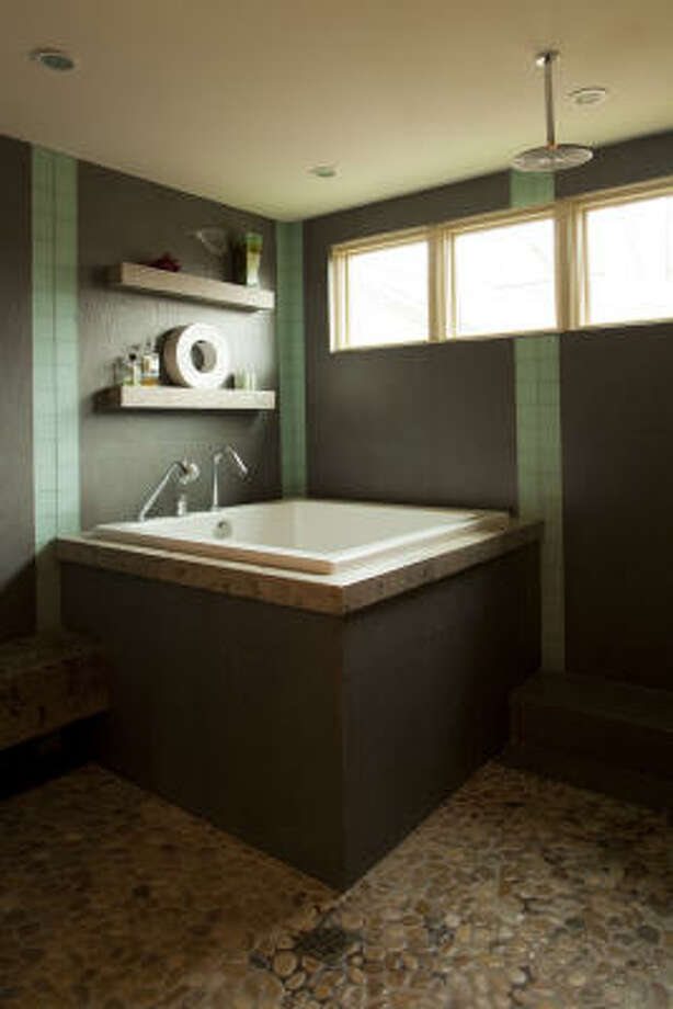Denmon Sigler and Peter Chok wash their worries away in a Japanese tub in the master bath. Photo: Jill Hunter, For The Chronicle