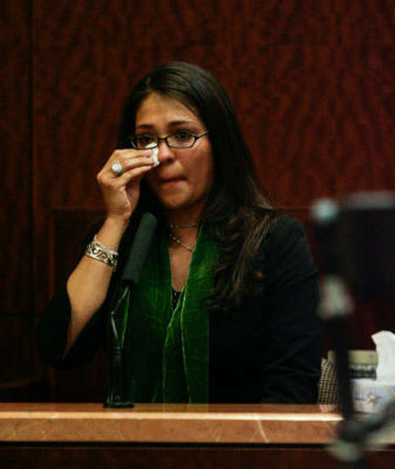 Ariana Venegas cries on the stand as she testifies in court against Harris County Court-at-Law Judge Donald Jackson at the Harris County Criminal Justice Center. Photo: Billy Smith II, Chronicle