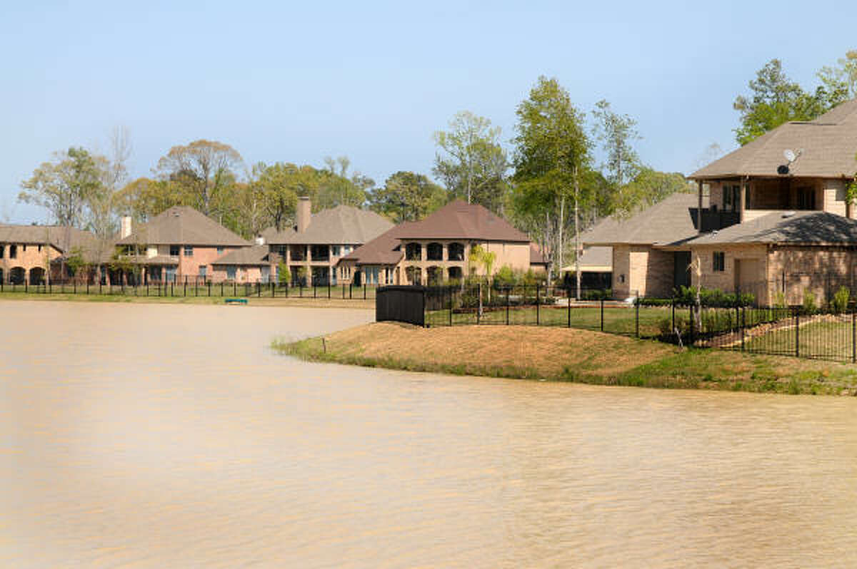 DAVID HOPPER: FOR THE CHRONICLE LAKE-SIDE LIVING: Tupelo Lake homes offer homeowners lake-side living in the Village of Creekside Park in The Woodlands. Creekside Park is the newest village in The Woodlands. Photo by David Hopper.