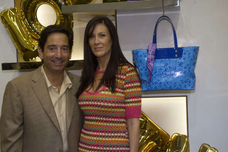 David and Natalie Reitman check out the goods at the Louis Vuitton event at Neiman Marcus in the Galleria. Photo: Johnny Hanson, Chronicle