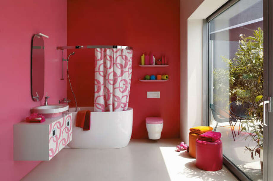 """mini contemporary: This sun-drenched retro bathroom hosts a tiny, contemporary freestanding tub. Part of the """"mimo"""" series of fixtures by Laufen, the tub has been called the """"Mini Cooper of the bathroom."""""""