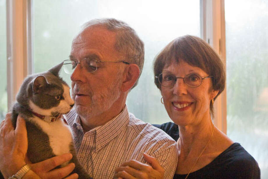 Tim Hebert and Elizabeth Koch of Braeswood Pet Rescue are with their cat, Spencer. Photo: R. Clayton McKee, For The Chronicle