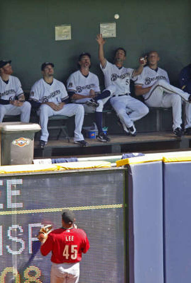 Carlos Lee watches Casey McGehee's blast land in the Milwaukee bullpen for a three-run home run. Photo: Jeffrey Phelps, AP
