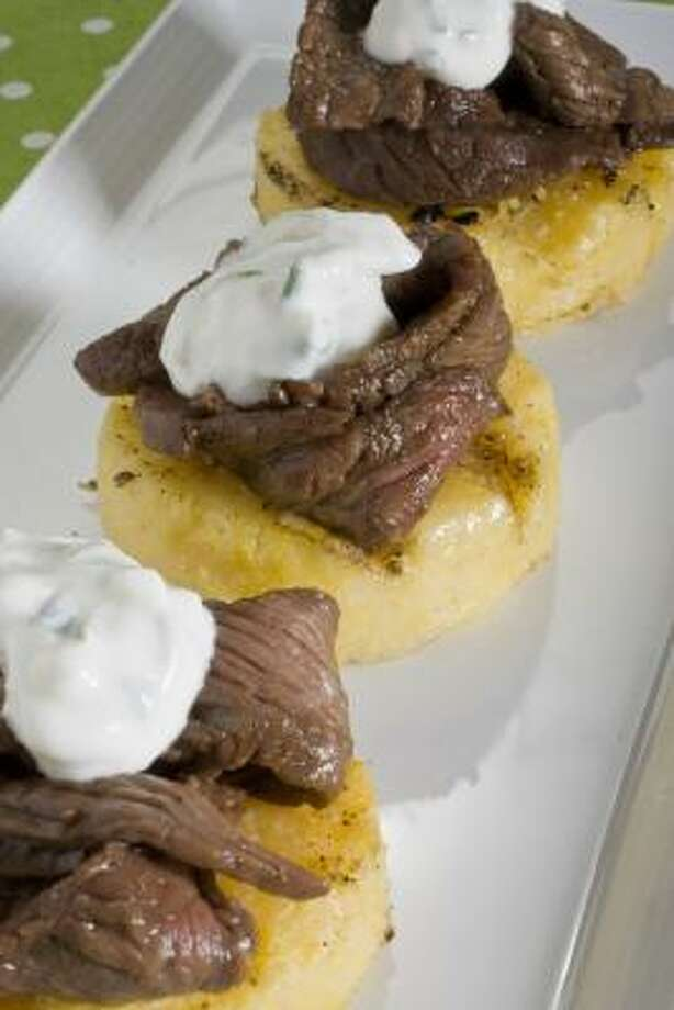 Grilled Sirloin With Polenta and Sour Cream Photo: LARRY CROWE :, ASSOCIATED PRESS