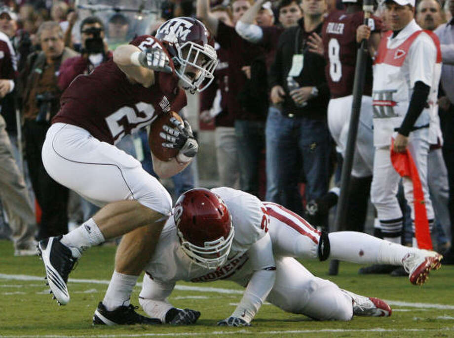 Texas A&M wide receiver Ryan Swope spends much of his on-field time sprinting in the Aggies' up-tempo offense. Photo: Julio Cortez, Chronicle