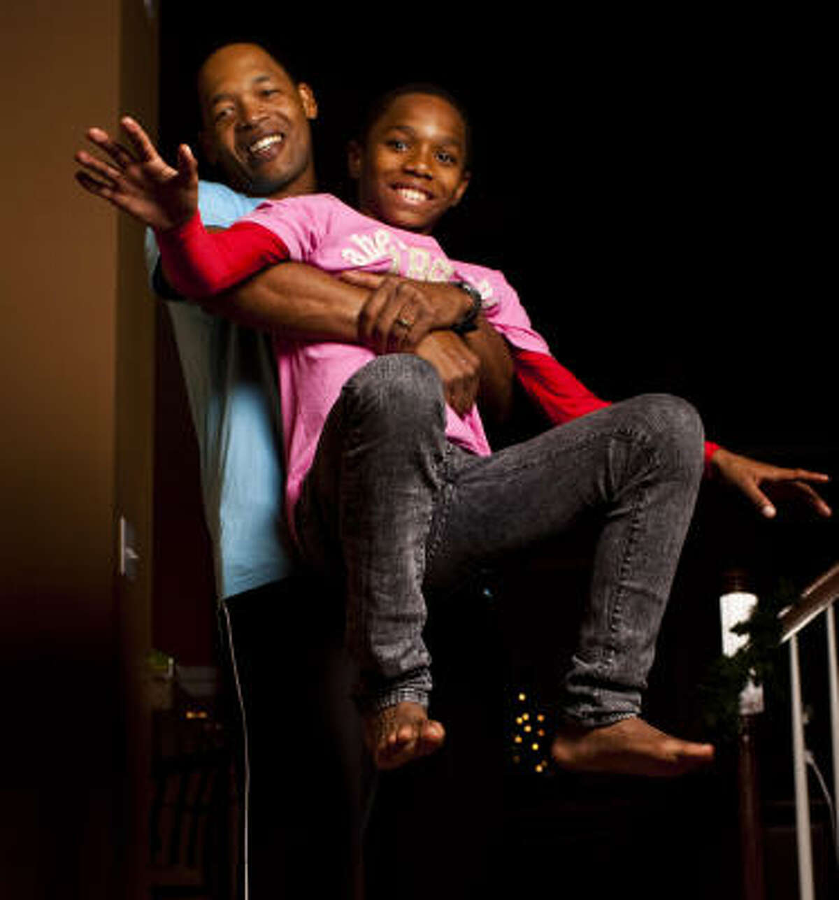 Ten-year-old Tyler and his firefighter father, Rodney Hudson, demonstrate a playful maneuver Tyler credited with helping him save a choking classmate.