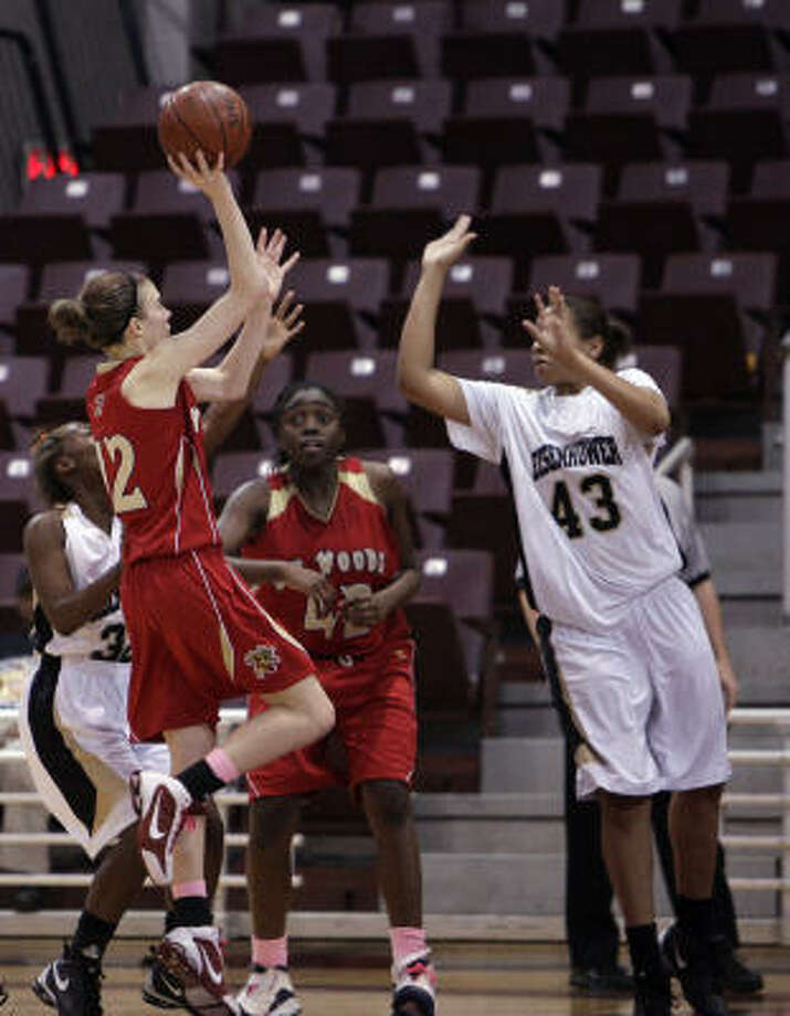 Cy Woods guard Jennifer Nash shoots over Eisenhower's Ashley Charles (43) during Monday night's victory. Photo: Bob Levey, For The Chronicle