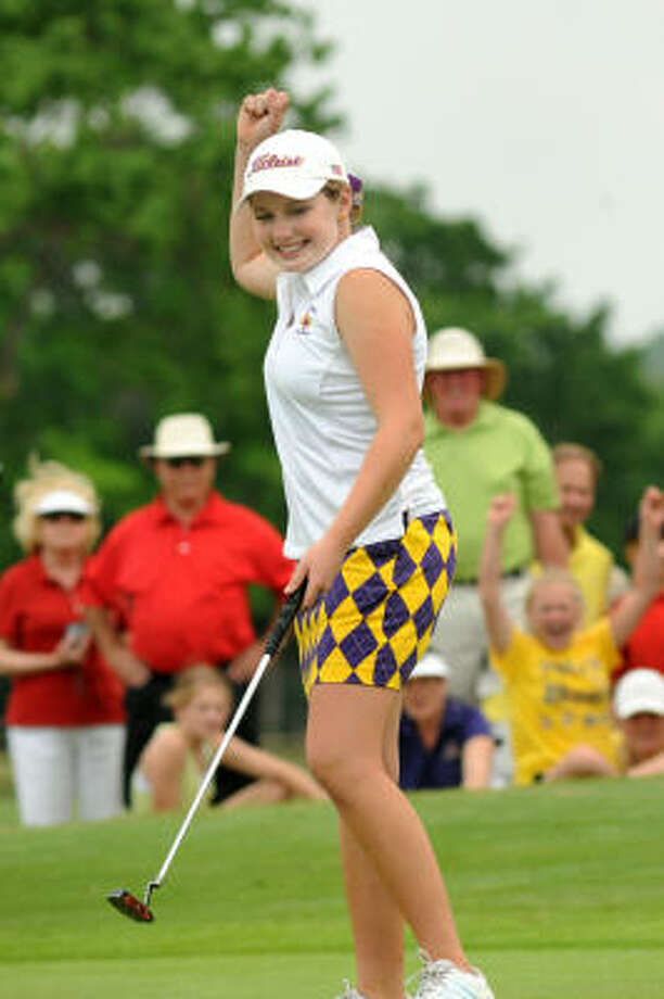 Montgomery's Abby Corson celebrates her par-saving putt on the final hole of her round on Tuesday. Photo: JERRY BAKER, For The Chronicle