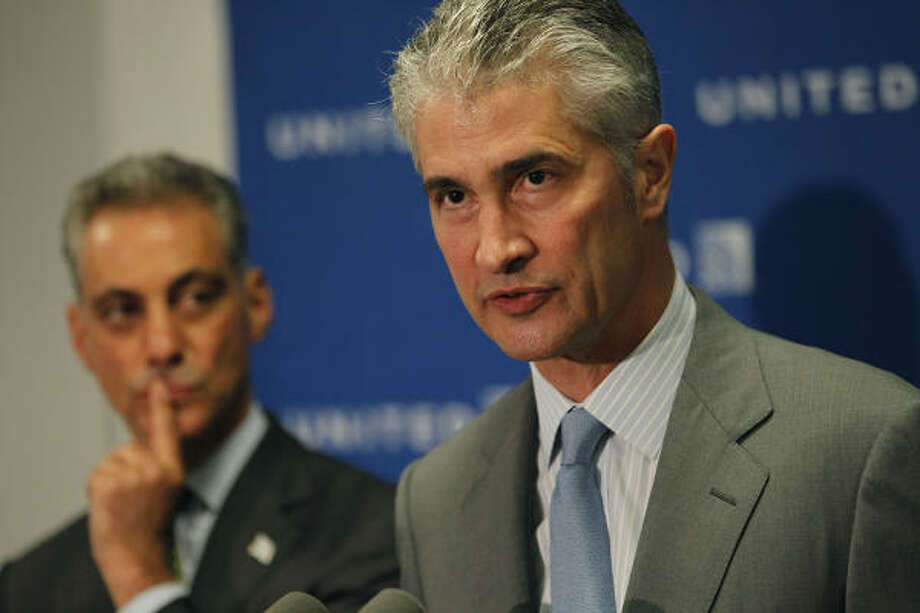 Chicago Mayor Rahm Emanuel listens as United Continental Holdings CEO Jeff Smisek speaks during a news conference on Friday at United's headquarters in the Willis Tower. Smisek said 1,300 positions will be added in Chicago. Photo: Chris Walker:, Chicago Tribune