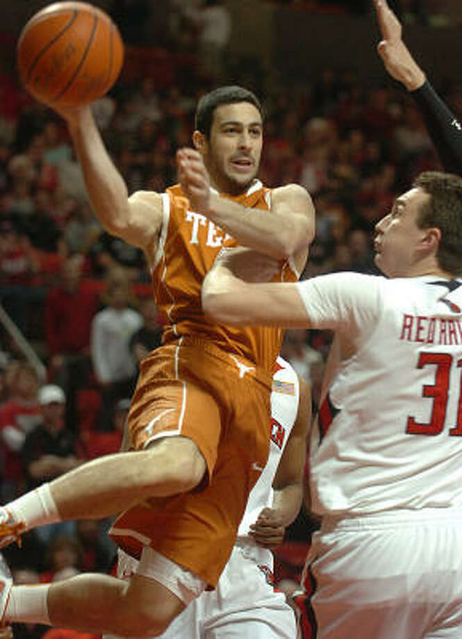 Dogus Balbay led the Longhorns with 3.9 assists per game before his knee injury. Photo: Zach Long, AP