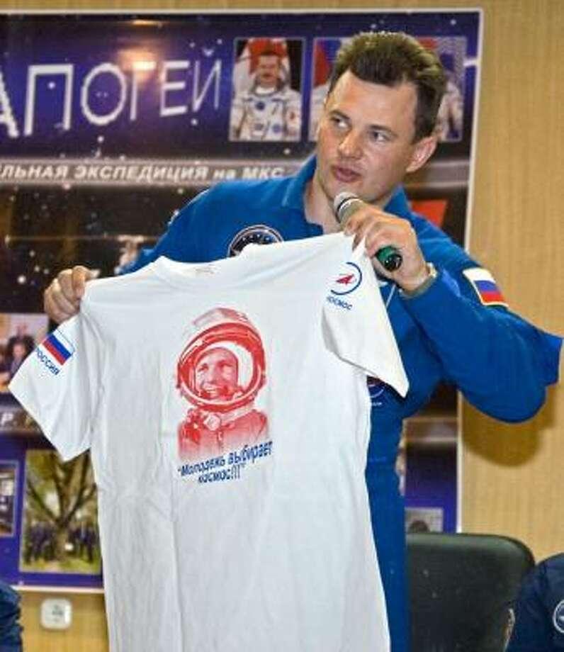 Russian cosmonaut Roman Romanenko talks about the launch. Photo: Sergey Ponomarev, AP
