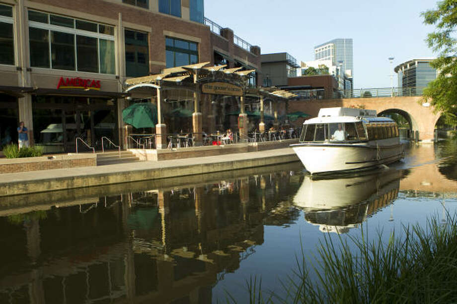 Americas and The Goose's Acre patios grace the Waterway development in The Woodlands. The project is expected to be twice its size in the next six years. At least two new restaurants are expected to join the project, and others are in negotiations, developers say. Photo: Brett Coomer, Chronicle