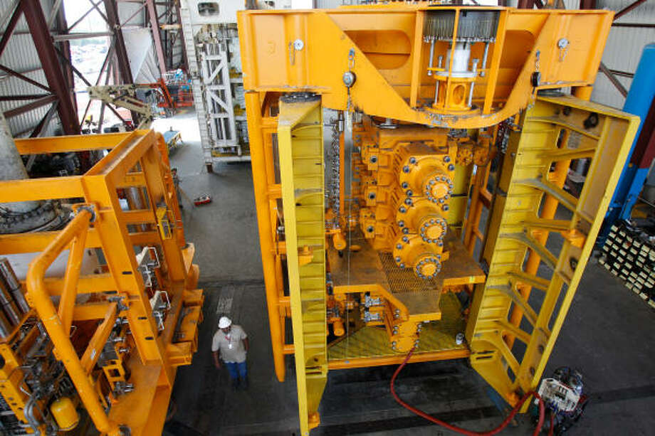 A lower marine riser package, left, and a lower blowout preventer stack at National Oilwell Varco can help meet new safety rules. Photo: Melissa Phillip, Chronicle