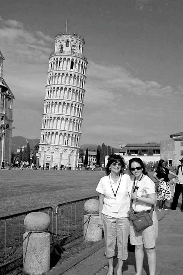 Barbara Spasiano of Old Greenwich, left, and Frances Avery of Greenwich stand in front of the Leaning Tower of Pisa. Photo: Contributed Photo