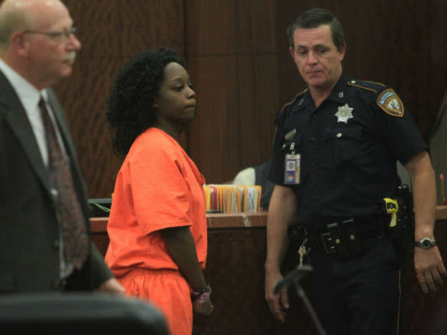 Danielle Hudson, 21, appears in the 337th State District Court at the Harris County Criminal Courthouse on Sunday. Hudson and her boyfriend, Chaz Omar Blackshear, were arrested Friday night and have been charged in the slayings of cabdrivers Mohammed Nabiil Elsayed and Blaise Uzoma Nwokenaka. The pair confessed to their roles in the crimes and provided evidence, police say. Photo: Mayra Beltran, Chronicle