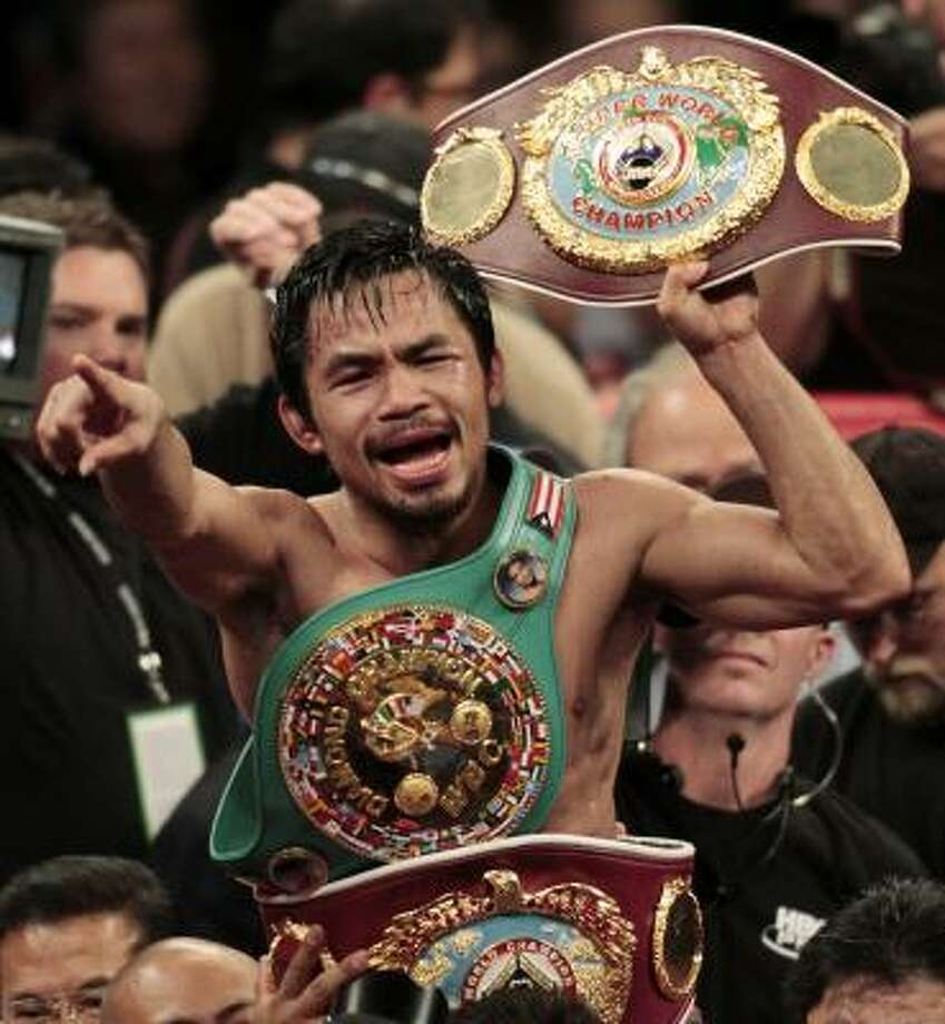 Manny Pacquiao (pictured) and floyd Mayweather Jr. must submit to the tests within 48 hours or face possible fines or suspension by the Nevada Athletic commission. Photo: Isaac Brekken, AP