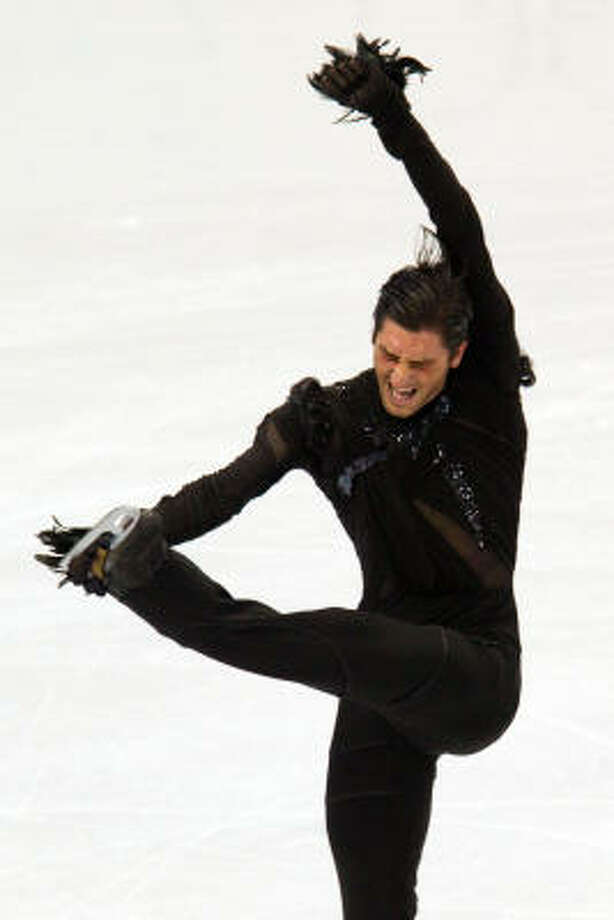 Evan Lysacek trails defending gold medalist Evgeni Plushenko by .55 points with the free skate remaining. Photo: Smiley N. Pool, Chronicle Olympic Bureau