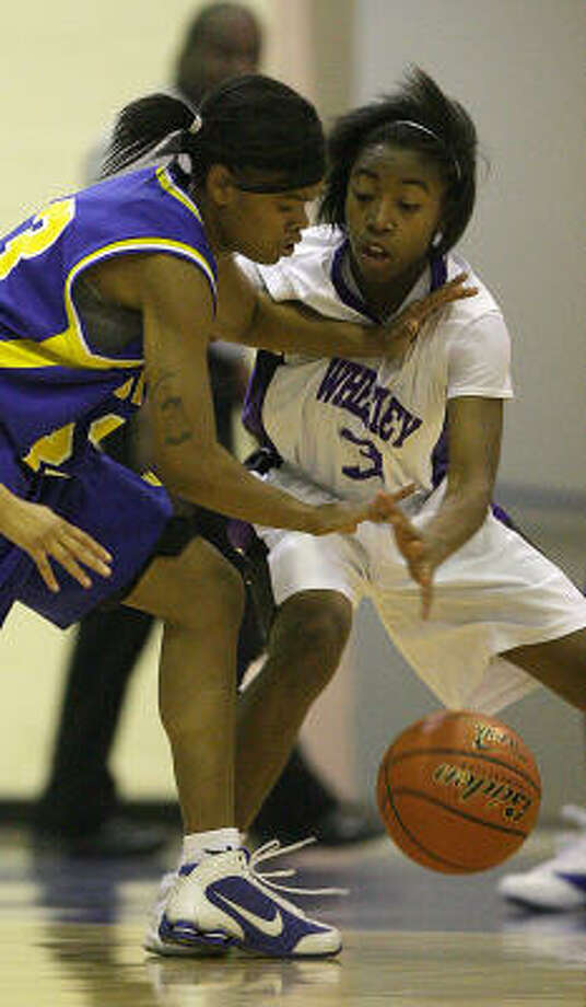 Wheatley's Diamonisha Sophus (3) battles for the ball with Booker T. Washington's Candace Collins during the second half on Monday. Photo: Karen Warren, Chronicle