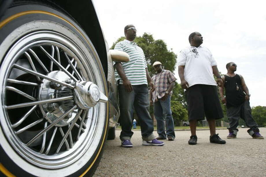 Members of the Block Boyz, from left, Al, Adrian E., Be and Young Chado, created a YouTube video about swangers, a type of wire rim that sticks out near the center. Photo: Julio Cortez, Chronicle