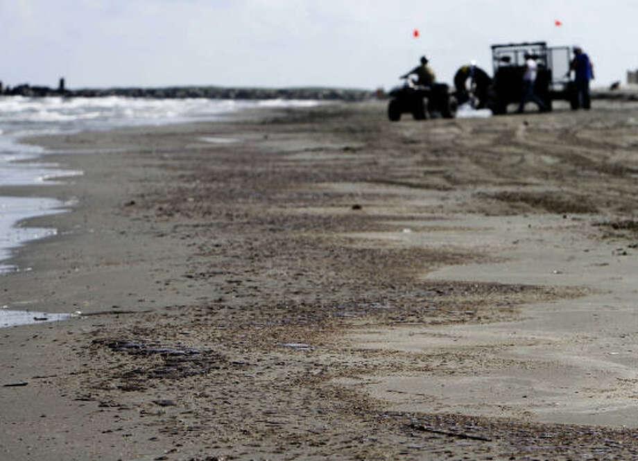 Oil covers the sand on the beach in Grand Isle, La., on Thursday. Photo: Matt Stamey, Associated Press