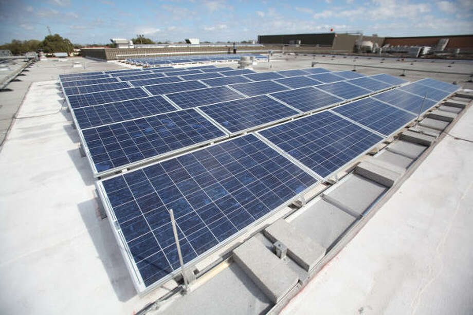This solar array atop Sam Rayburn High School - and its twin on South Houston High School - are predicted to save the Pasadena Independent School District $15,000 a year on its electricity bill. Photo: Mayra Beltran, Chronicle