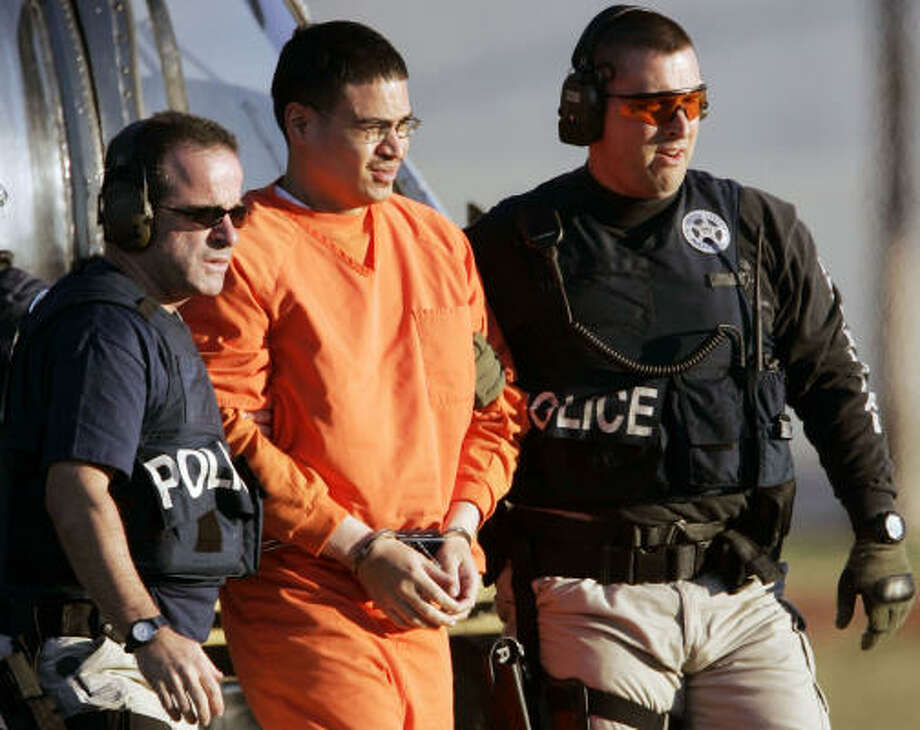 Jose Padilla is escorted by federal marshals on his arrival in Miami in January. Photo: ALAN DIAZ, AP