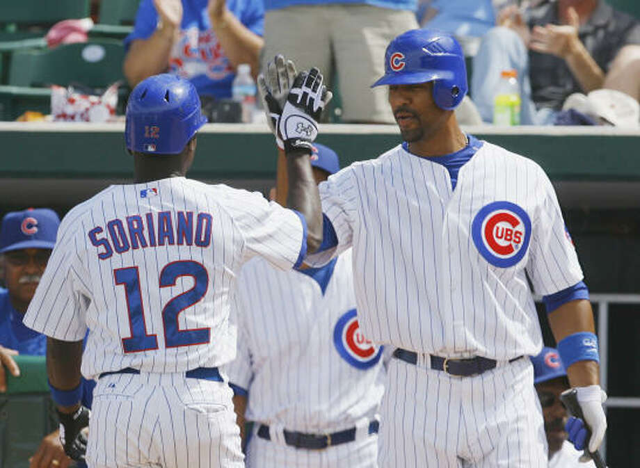 With the addition of Alfonso Soriano, left, and a healthy Derrek Lee, the Cubs are primed to make a run at the NL Central title. Photo: Ross D. Franklin, AP