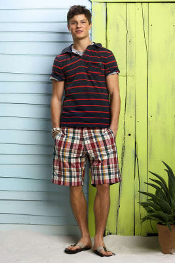 Plaid shorts, $36.50; striped polo, $34.50; a weathered gray T-shirt, $19.50; and flip-flops, $24.50; all at American Eagle Outfitters. Photo: American Eagle Outfitters
