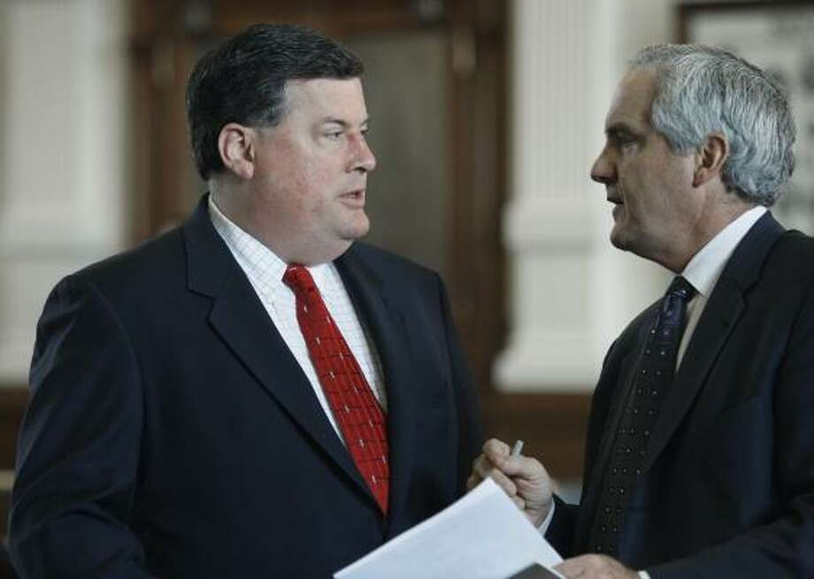 Sen. Tommy Williams, R-The Woodlands, left, talks with Sen. Eliot Shapleigh, D-El Paso, during Friday's session in the Texas Senate. As lawmakers inched closer to a compromise on a transportation bill that Texas Gov. Rick Perry has threatened to veto, Williams said mediators were working on a few remaining issues. Photo: Harry Cabluck, AP